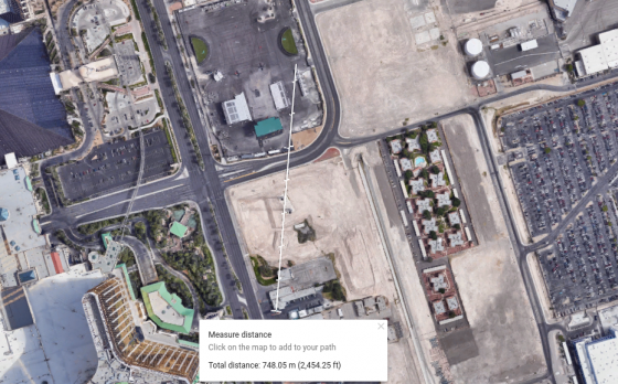 "The total distance from the billboard outside ""Mr. Deli"" to where the videographer was standing is 748.05 m (2,454.25 ft), according to the ""measure distance"" feature on Google Maps."
